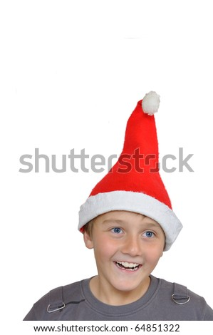 Smiling adorable child with Santa Hat - stock photo