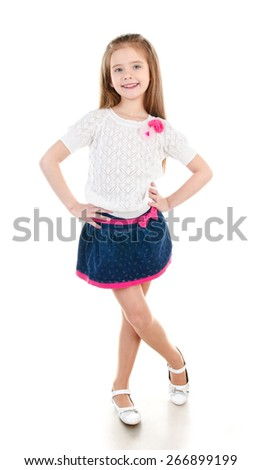 Smiling adorable little girl in skirt isolated on a white - stock photo