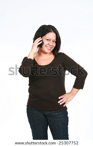 smiling adult hispanic woman talking on cell phone