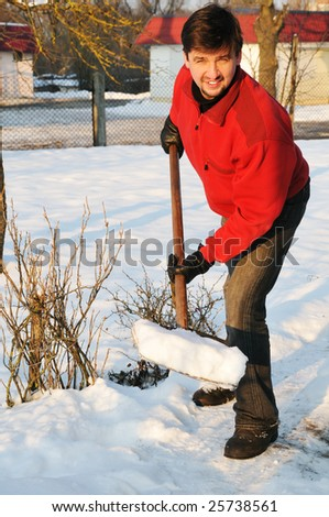 smiling adult man clean owns yard against snow - stock photo