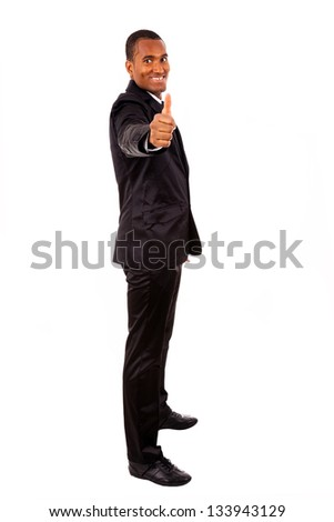 Smiling African American business man gesturing a thumbs up sign on white background - stock photo