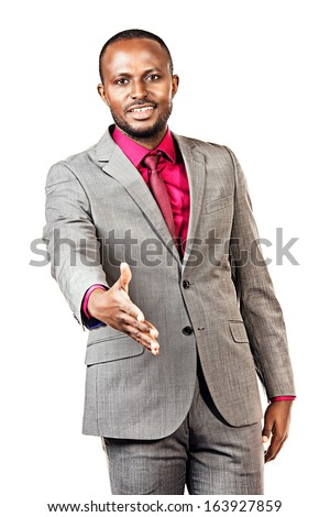 Smiling african american business man stretches out his hand for a handshake. Isolated over white.
