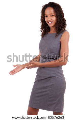 Smiling african american  business woman making a welcoming gesture - stock photo