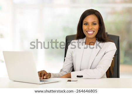 smiling african american business woman using laptop computer - stock photo