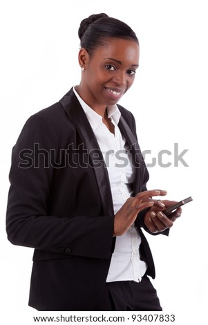 Smiling african american businesswoman using a smartphone, isolated on white background