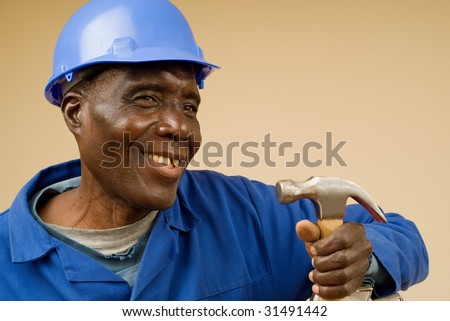 Smiling African American Construction Worker Holding Hammer - stock photo