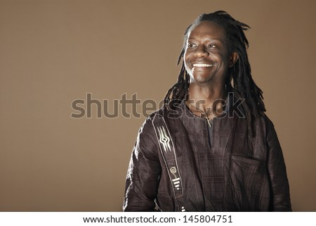 stock-photo-smiling-african-american-man-with-dreadlocks-looking-away ...