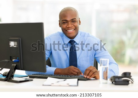 smiling african american office worker looking at the camera - stock photo