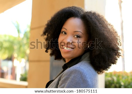 Smiling African American Professional Business Person Pretty Beautiful Wearing Black Shirt and Suit - stock photo