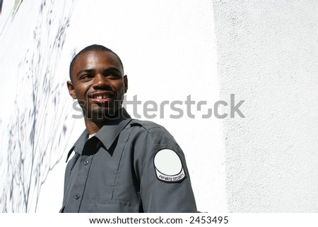 smiling african american security gaurd - stock photo