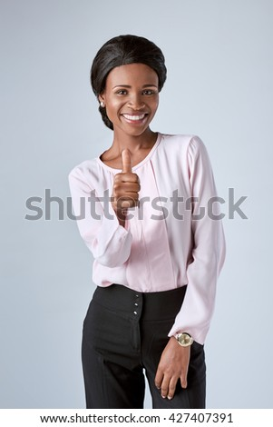 Smiling african business woman laughing in studio