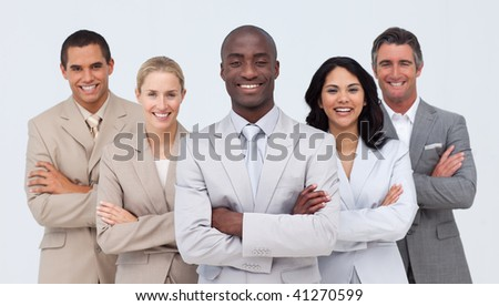 Smiling African businessman leading his team against white background - stock photo