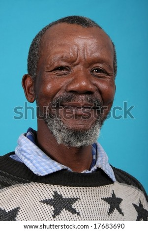 Smiling African gentleman with a beard - stock photo