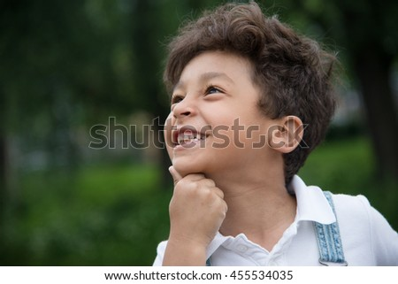 smiling afro-american boy look left and up. close up shot.  - stock photo