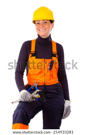 Smiling and Beautiful service woman wearing yellow helmet and blue orange coverall holding flat wrench and hammer.  Isolated on white background
