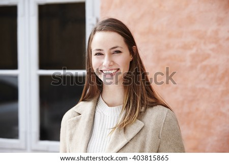Smiling and beautiful young woman, portrait