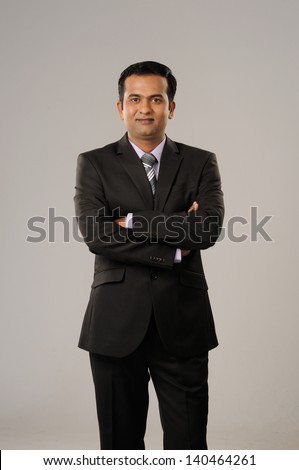 smiling and confident business man - stock photo