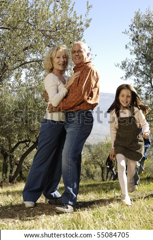 smiling and embracing couple in the country