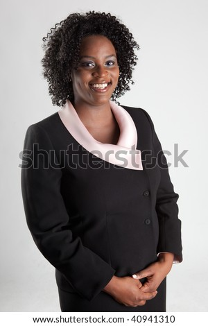 Smiling and happy african american business woman - stock photo