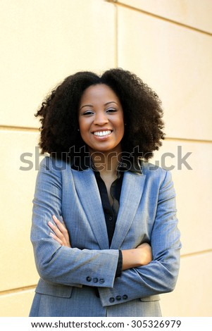 Smiling and Happy Professional African American Business Woman Black Hair Africa Arms Crossed Wearing Suit  - stock photo