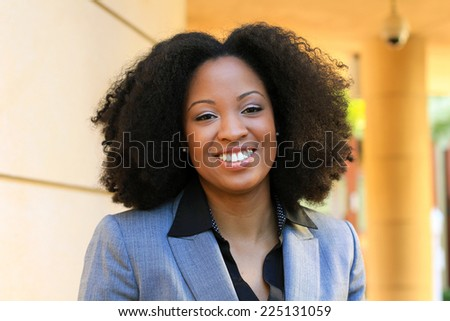 Smiling and Happy Professional Attractive African American Business Woman Person Black Hair Wearing a Suit