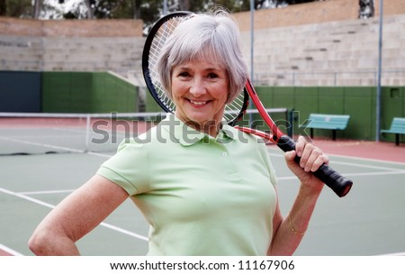 Smiling and Healthy Senior on the Tennis Court. - stock photo