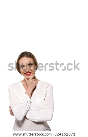Smiling and pensive young woman looking away isolated on white with copy space - stock photo