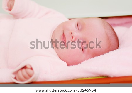 smiling and sleeping  baby - stock photo