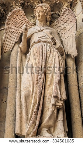 Smiling angel in the Cathedral Reims, France - stock photo