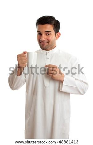 Smiling arab man wearing a robe, thobe, Kurta, dishdasha, etc. He is enjoying a cup of coffee.  The coffee plant was first recognized in Yemen in Arabia cultivation of coffee first expanded in Arabia - stock photo