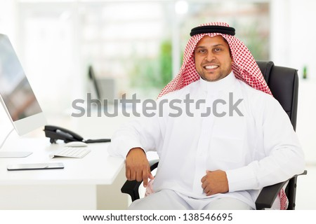 smiling arabian business man in office