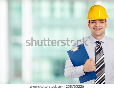 Smiling architect at his office - stock photo