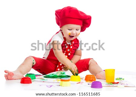 smiling artist child painting by fingers - stock photo