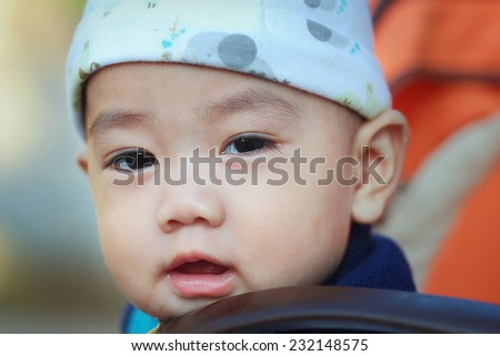 smiling asian baby, close-up - stock photo
