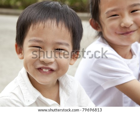 smiling asian boy and girl - stock photo