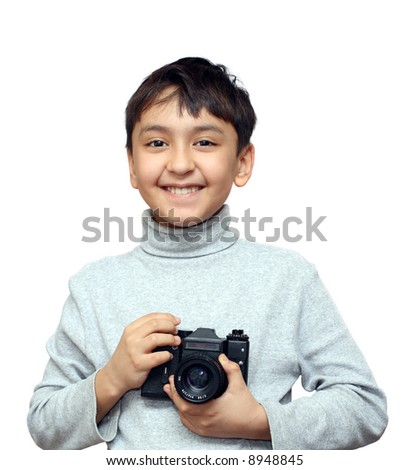 smiling asian boy with camera isolated on white - stock photo