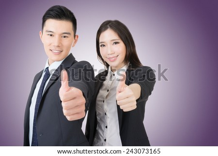 Smiling asian business man and woman gives you thumbs up gesture. Closeup portrait. - stock photo