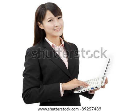 smiling asian business woman holding laptop - stock photo