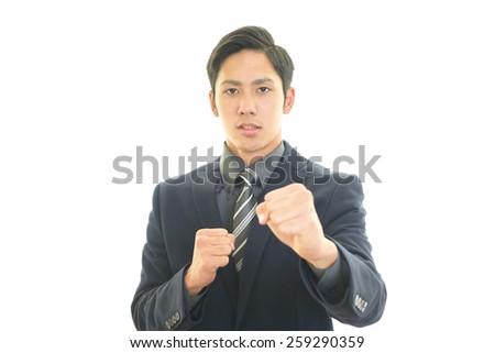Smiling Asian businessman - stock photo
