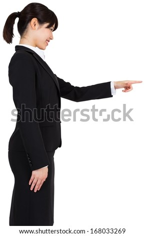 Smiling asian businesswoman pointing
