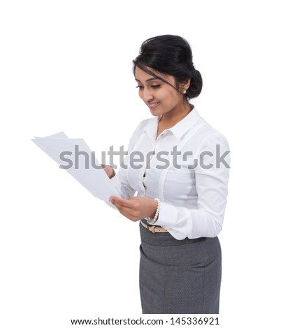 Smiling Asian businesswoman with documents  - stock photo