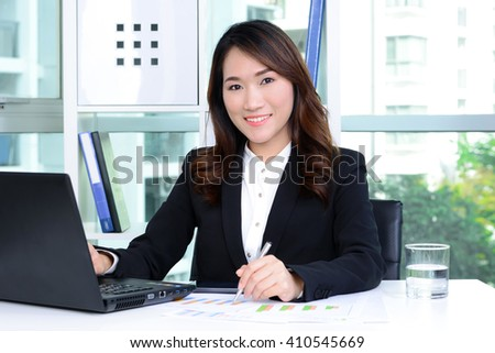 Smiling Asian businesswoman working in the office