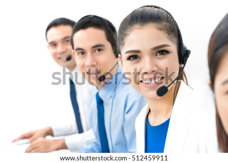 Smiling Asian call center (or telemarketer) team