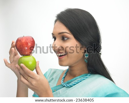 Smiling Asian  girl with red and green apple - stock photo