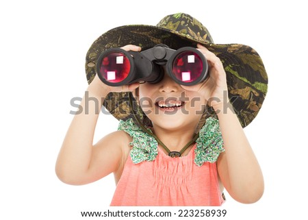smiling asian Little girl looking through binoculars. isolated on white background - stock photo