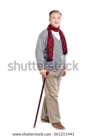 smiling Asian old man in sweater and scarf with cane - stock photo