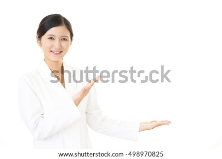 Smiling Asian pharmacist
