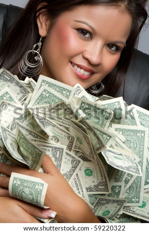 Smiling asian woman holding money - stock photo