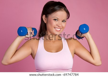 Smiling asian woman lifting weights - stock photo