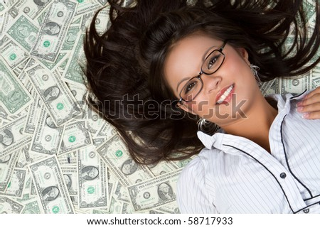 Smiling asian woman with money - stock photo